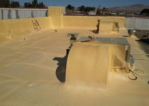 Spray polyurethane foam roofing system